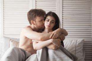 Boyfriend hugging girlfriend asking for forgiveness
